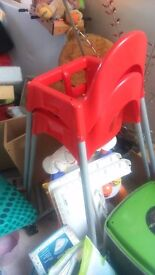 Two red ikea high chairs