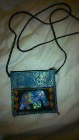 Beautiful elephant bag with elephant pendant, bracelet, and earrings