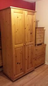 Solid pine bedroom set..4 post double bed.wardrobe.chest of drawers.bedside table