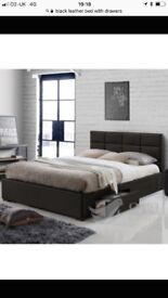 Black leather double bed with headboard and drawers