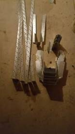 Joist hangers and wall plate straps