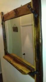 Rustic wooden mirror with a shelf