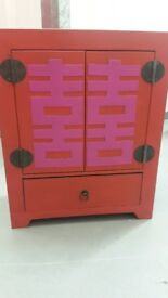 Small, red and pink, chinese style storage cabinet