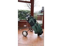 Set of golf irons, clubs, bag, trolley and extras