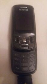 Black samsung slide mobile phone with charger
