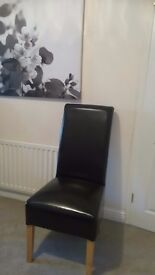 Black faux leather high back chairs