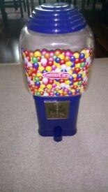 Gumball machine. Large gumball machine activated with coins.