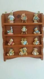 A selection of Cherished Bears with display shelf.