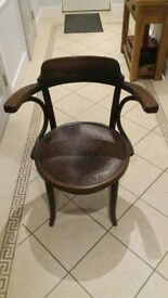 Captains chair. A real one with arms and beautiful inlay carving.