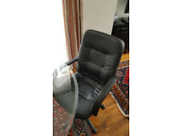 Swivelling office chair, faux leather, black