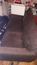 Brown 2 seater sofa £50. Collection New Basford.