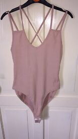 New Look Dusky pink cross back bodysuit , size 12 (will fit size 10-12) , BRAND NEW WITH TAGS