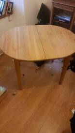 Light oak extendable dining table wth 2 chairs