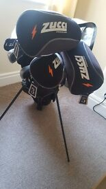 Zucci golf clubs with bag.