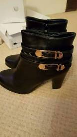 Ladies brand new black boots size 5 with buckle detail.