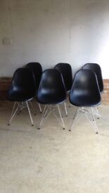 Six classic chrome leg black mounded seat designer style chairs