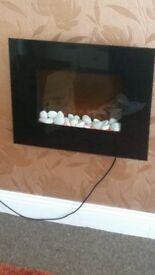 Black glass wall mounted electric fire