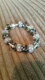 charm bracelet with 14 murano glass beads