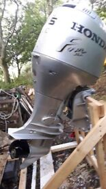 Honda 75HP Outboard 1999 with remotes.