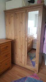 wooden wardrobe with a mirror