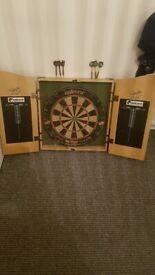 Phil traynor Dart board in cabinet
