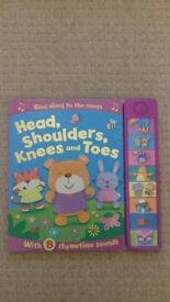 Like new - Head, Shoulders, Knees and Toes musical book comes with batteries