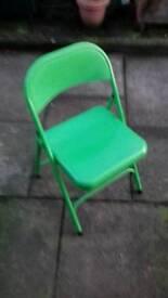 Folding up metal chair