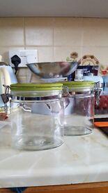 2 medium sized green storage jars