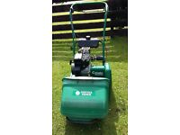 suffolk punch 14 s petrol cylinder mower with scarifying attachment