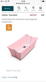 Pink stokke baby bath and safety seat