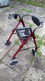 Four wheeled walker with seat and basket.