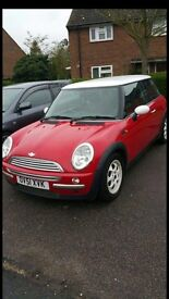 Red Mini Cooper hatch 1.6 good condition only 2 previous owners