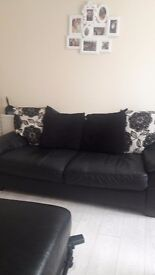 Black leather and fabic sofas 2 from scs well made and comfortable