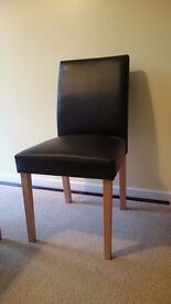 Black leather effect chair. Boxed. In kit form.