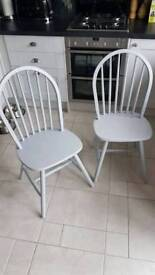 4 grey wooden chairs