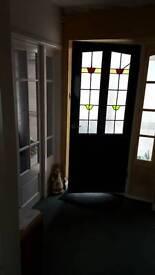 Hardwood door with lead glass