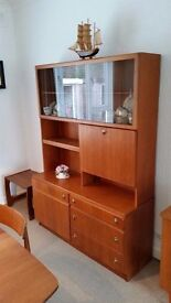 Tall sideboard, in teak, by McIntosh with display cab. and cutlery drawer.