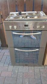 An electric hob and double oven.