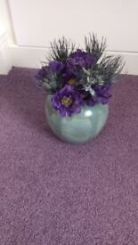 Grey vase with purple flowers - ideal gift cellophane wrapped.
