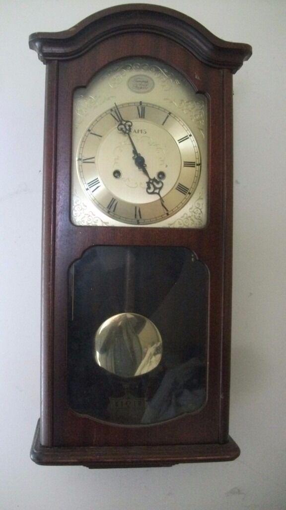 FRANZ HERMLE & SONNE 31 DAY MAHOGANY STRIKING WALL CLOCK, £60.00
