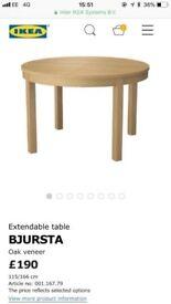 Ikea Bjursta round extendable dining table