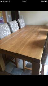 Solid Oak dining table and six chairs.