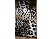 Brand new unused large animal print rugs x 2