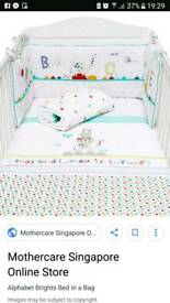 Nearly New unisex cot bed set with matching light shade, cot mobile and grobag.