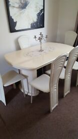 Cream dining table and chairs