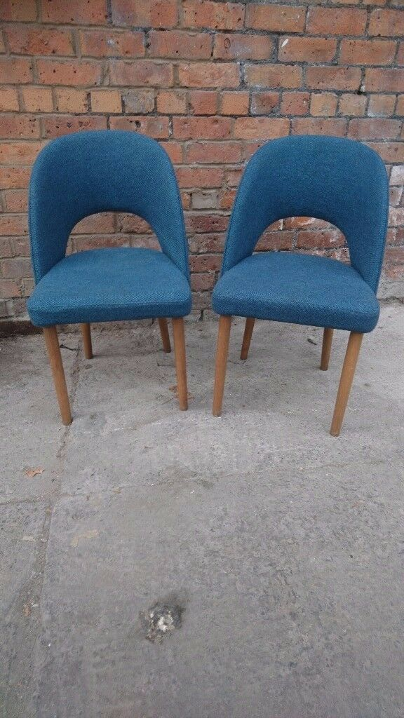 Two fameg occasional chairs in pale blue