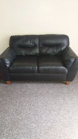 2 Two Seater Black Leather Sofas