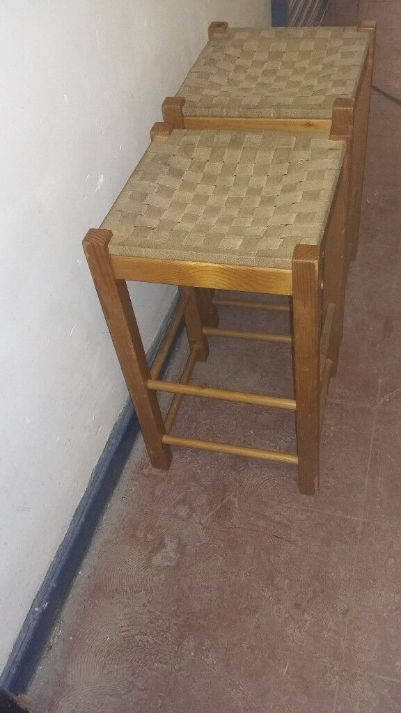 2 wood framed high stools with woven pattern seats