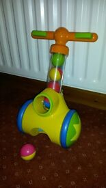 Tomy Toddler walk behind ball shooter. Scoops up and shoots out balls.