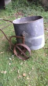 vintage water carrier, plant holder, ornament, iron wheels